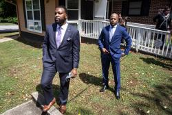 Lee Merritt, left, and Chris Stewart, attorneys for the mother of Ahmaud Arbery, are seen at a news conference on Wednesday, May 19, 2020, in East Point, Georgia.