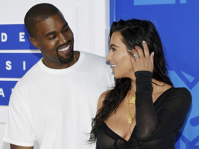 Kanye West, left, and Kim Kardashian West arrive at the MTV Video Music Awards in New York.