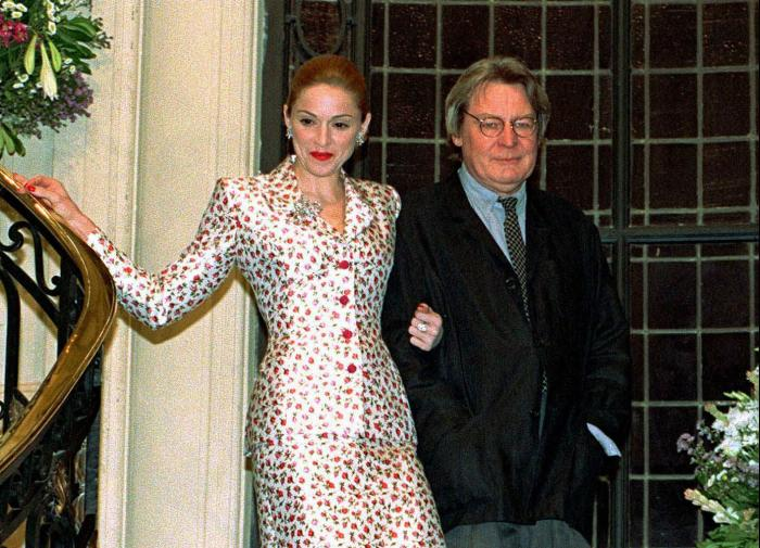 "Actress-singer Madonna arrives for a news conference about the musical film ""Evita"" with British director Alan Parker in Buenos Aires on Feb.6, 1996."