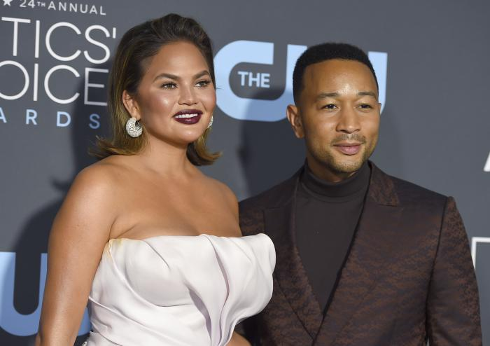 Chrissy Teigen, left, and John Legend arrive at the 24th annual Critics' Choice Awards on Jan. 13, 2019, in Santa Monica, Calif.