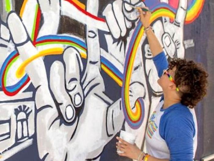 "Acclaimed artist Lisa Marie Thalhammer paints the mural ""Spirit of Stonewall"" in Key West, Florida."