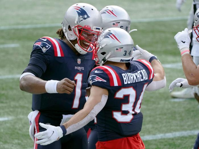 New England Patriots quarterback Cam Newton (1) celebrates his touchdown pass to running back Rex Burkhead (34) in the first half of an NFL football game against the Las Vegas Raiders, Sunday, Sept. 27, 2020, in Foxborough, Mass.