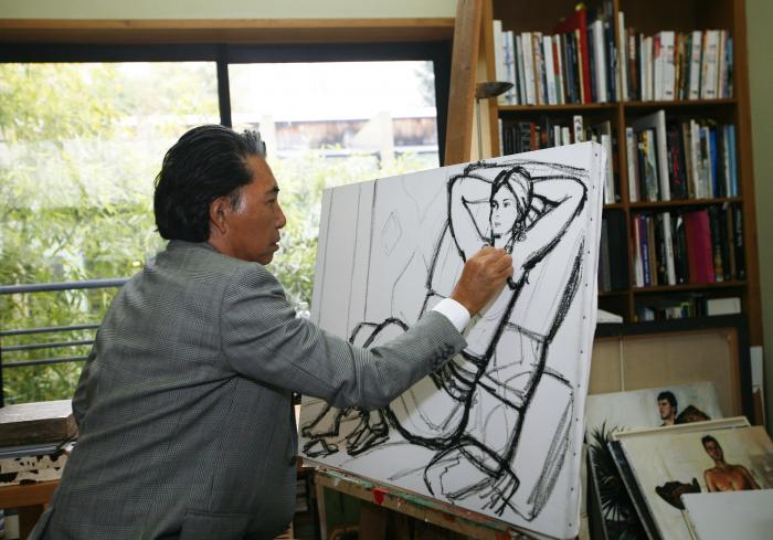 n this Tuesday, March 24, 2009 file photo, Japanese fashion designer Kenzo Takada sketches in his Paris house.