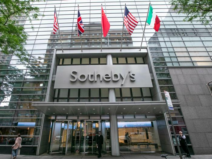 This June 17, 2019 file photo shows the front entrance of Sotheby's auction house in New York. Sotheby's helped an art collector dodge millions of dollars in New York sales taxes, the New York attorney general said in a lawsuit filed Friday, Nov. 6, 2020