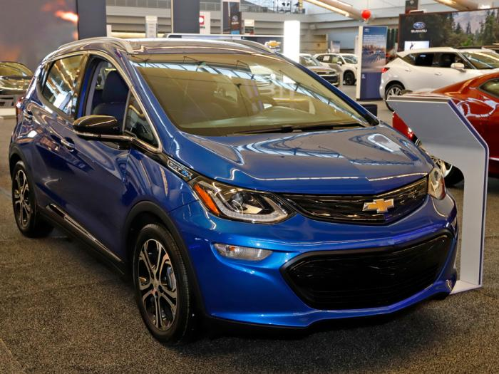 In this Feb. 13, 2020 file photo a 2020 Chevrolet Bolt EV is displayed at the 2020 Pittsburgh International Auto Show in Pittsburgh. On Thursday, Nov. 19, 2020