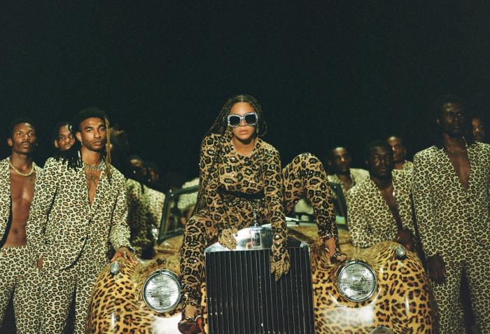 """Beyonce, center, in a scene from her visual album """"Black is King."""
