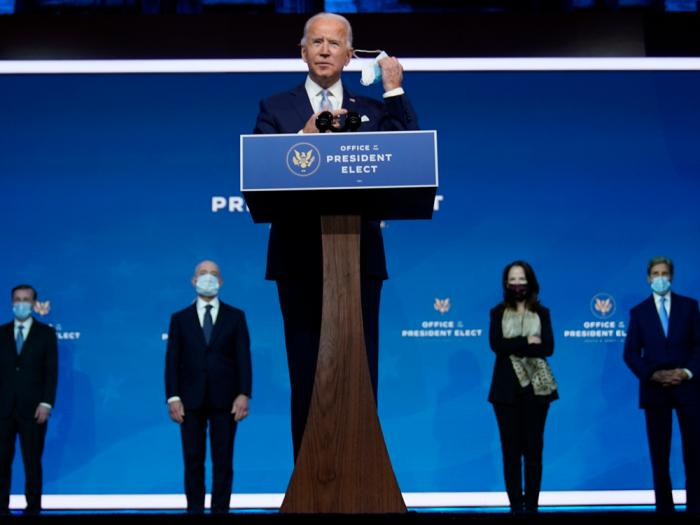 President-elect Joe Biden removes his face mask as he arrives to introduce his nominees and appointees to key national security and foreign policy posts at The Queen theater, Tuesday, Nov. 24, 2020, in Wilmington, Del.