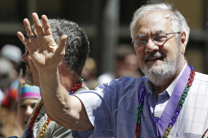 Former Massachusetts congressman Barney Frank, right, waves while riding with his husband James Ready, left, during the 44th annual San Francisco Gay Pride parade in San Francisco.