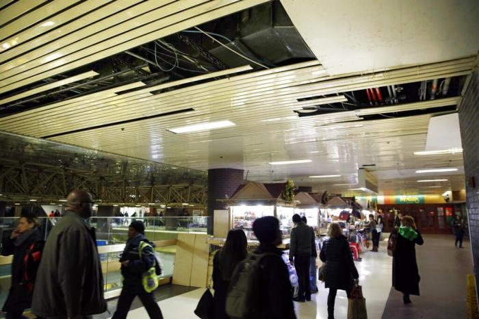 In this March 19, 2015 file photo, large panels of the ceiling are missing at the Port Authority Bus Terminal in New York.
