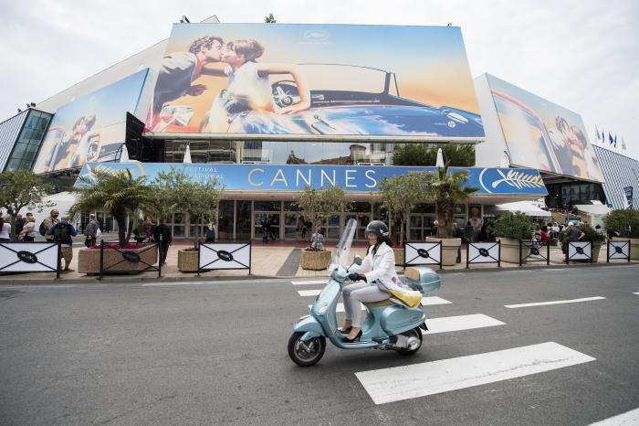 A scooter drives by the Palais des Festivals at the 71st international film festival, Cannes, southern France.