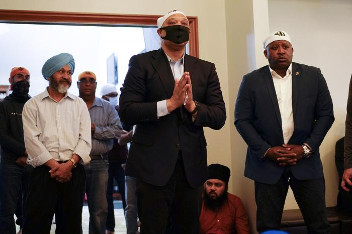 Rep. Andre Carson, D-Ind., speaks with members of the Sikh Coalition at the Sikh Satsang of Indianapolis in Indianapolis, Saturday, April 17, 2021.