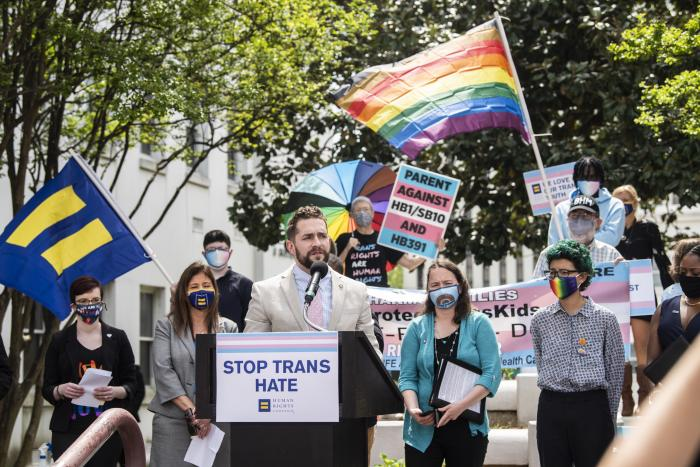 Alabama Rep. Neil Rafferty speaks in support of transgender rights during a rally outside the Alabama State House in Montgomery, Ala.