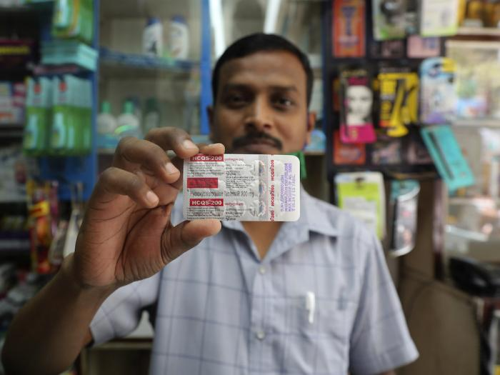 A chemist displays hydroxychloroquine tablets in Mumbai, India. With India's surge exploding, people are resorting to medical treatments that have not been approved internationally for COVID-19, causing shortages and booming black markets.