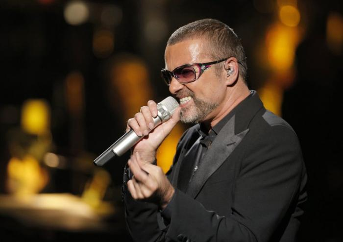 British singer George Michael sings in concert to raise money for AIDS charity Sidaction in 2012.