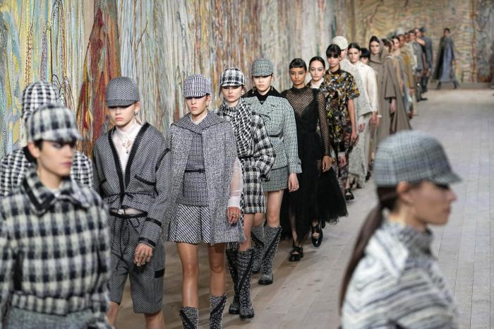Models wear creations for Dior's Haute Couture Fall-Winter 2021-2022 fashion collection in Paris.