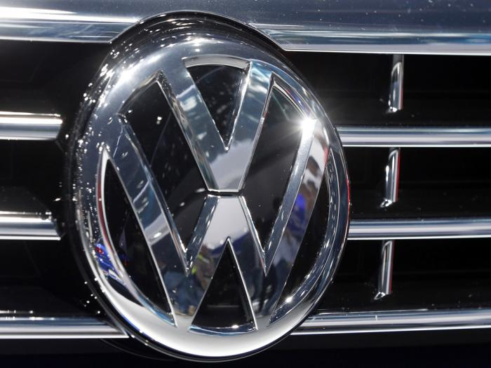 In this Sept. 22, 2015, file photo, the logo of Volkswagen at a car is photographed during the Car Show in Frankfurt, Germany