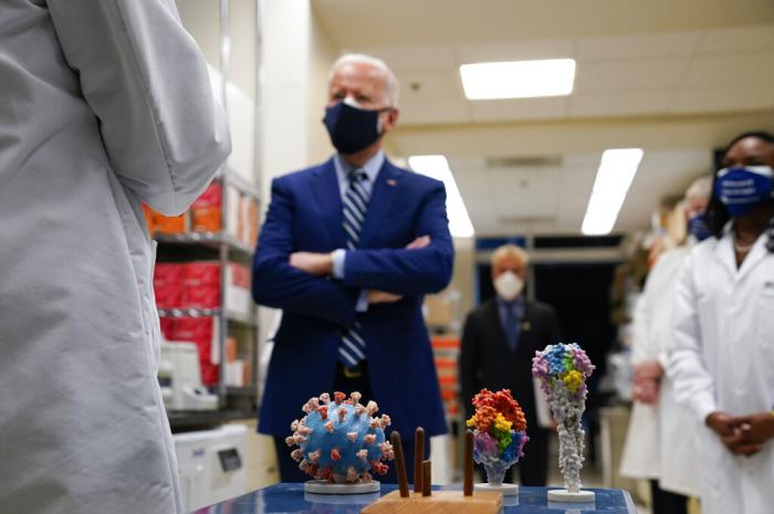 President Joe Biden visits the Viral Pathogenesis Laboratory at the National Institutes of Health (NIH) in Bethesda, Md.