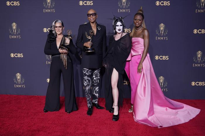 """Michelle Visage, from left, RuPaul Charles, Gottmik, and Symone pose for a photo with the award for outstanding competition program for """"RuPaul's Drag Race"""" at the 73rd Primetime Emmy Awards."""
