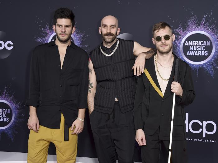 Adam Levin, from left, Sam Harris, and Casey Harris, of X Ambassadors, appear at the American Music Awards in Los Angeles.